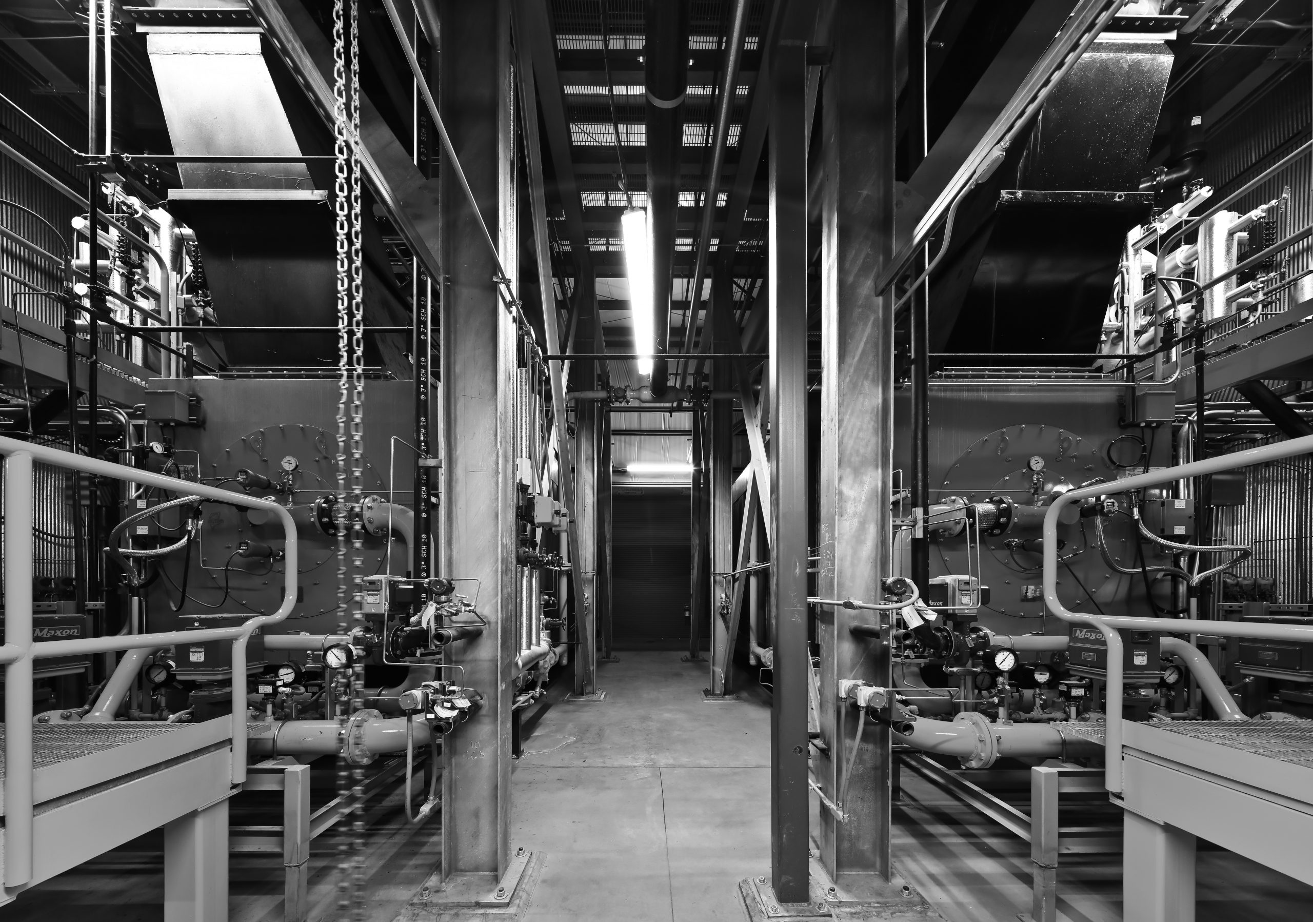 Black and white photo of two boiler units.