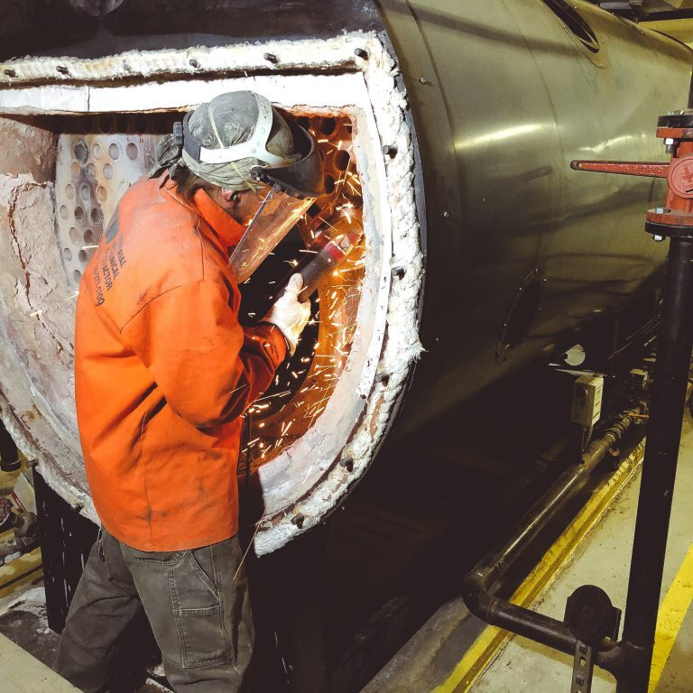 boiler-reconditioning-Josh grinding at Erieview_edited